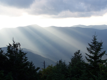 I cast my words into the sun.  This image shows sun rays radiating across the Blue Ridge Mountains of Western North Carolina, as viewed from the top of Mount Mitchell, the highest peak east of the Mississippi River.